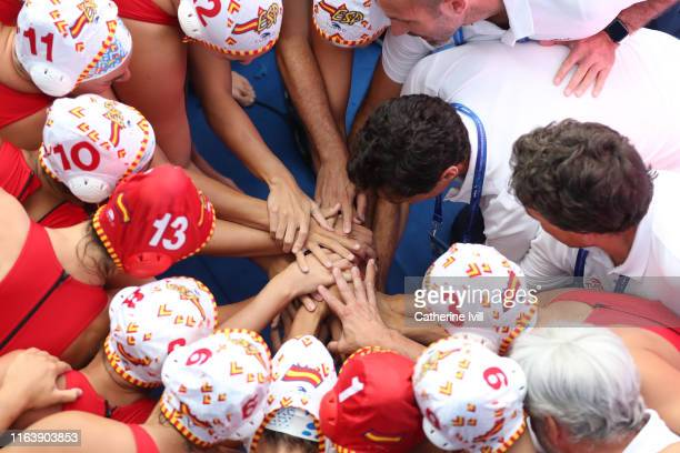 Head coach Miguel Angel Oca Gaia of Spain celebrates with his players during the Women's Water Polo Semifinal match between Spain and Hungary on day...
