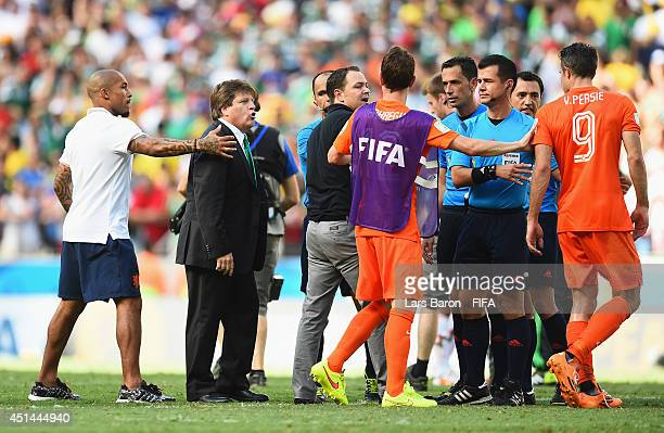 Head coach Miguel Herrera of Mexico and Robin van Persie of the Netherlands argue after the 2014 FIFA World Cup Brazil Round of 16 match between...
