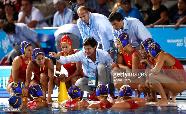 Head Coach Miguel Oca Gaia of Spain speaks with his players during the Women's Water Polo gold medal match between the Ubited States and Spain on day...