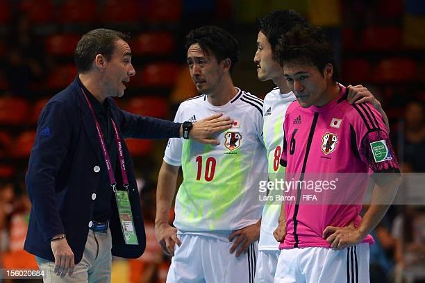 Head coach Miguel Rodrigo of Japan consoles his players Kenichiro Kogure Kensuke Takahashi and Nobuya Osodo after loosing the FIFA Futsal World Cup...