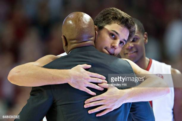 Head Coach Mike Anderson hugs Dusty Hannahs of the Arkansas Razorbacks during Senior day before a game against the Georgia Bulldogs at Bud Walton...