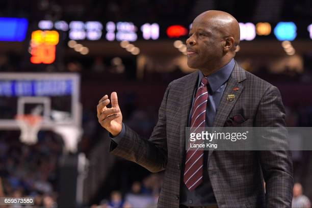 Head coach Mike Anderson of the Arkansas Razorbacks directs his team against the North Carolina Tar Heels during the second round of the 2017 NCAA...