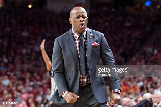 Head Coach Mike Anderson of the Arkansas Razorbacks reacts to a foul call during a game against the Oklahoma State Cowboys at Bud Walton Arena on...