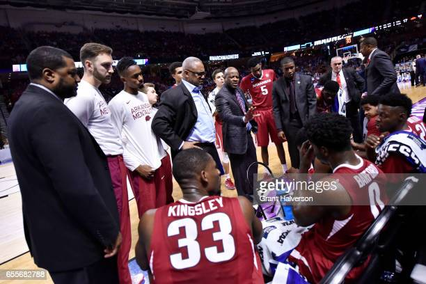 Head coach Mike Anderson of the University of Arkansas talks to his team during a time out in the game against the University of North Carolina...