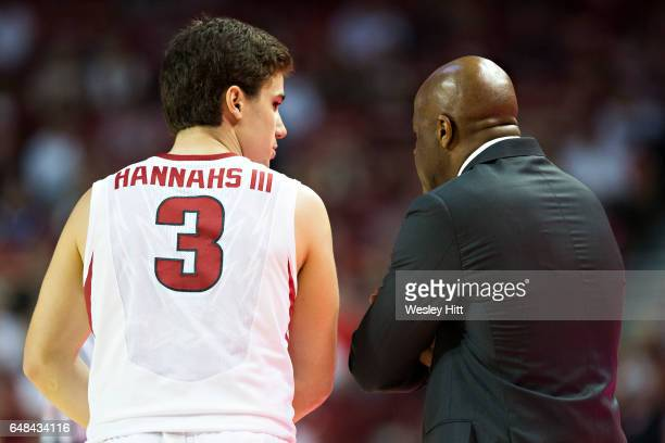 Head Coach Mike Anderson talks with Dusty Hannahs of the Arkansas Razorbacks during a game against the Georgia Bulldogs at Bud Walton Arena on March...