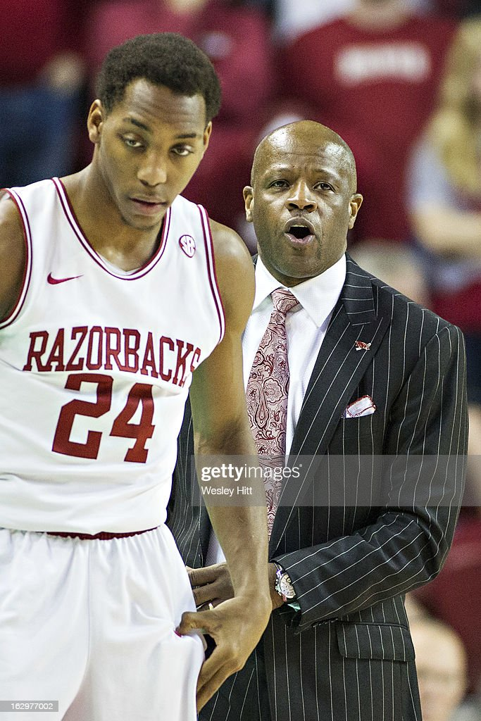 Head Coach Mike Anderson talks with Michael Qualls #24 of the Arkansas Razorbacks during a game against the Kentucky Wildcats at Bud Walton Arena on March 2, 2013 in Fayetteville, Arkansas. The Razorbacks defeated the Wildcats 73-60.