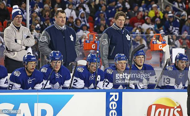 Head coach Mike Babcock and assistant coach DJ Smith of the Toronto Maple Leafs watch the action against the Detroit Red Wings during the 2017...