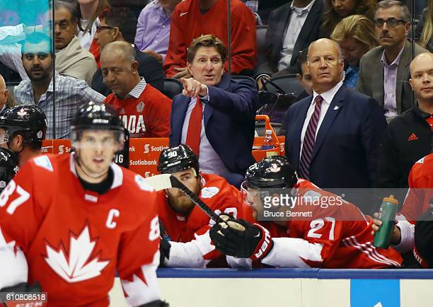 Head coach Mike Babcock and assitant coach Claude Julien of Team Canada handle bench duties against Team Europe during Game One of the World Cup of...