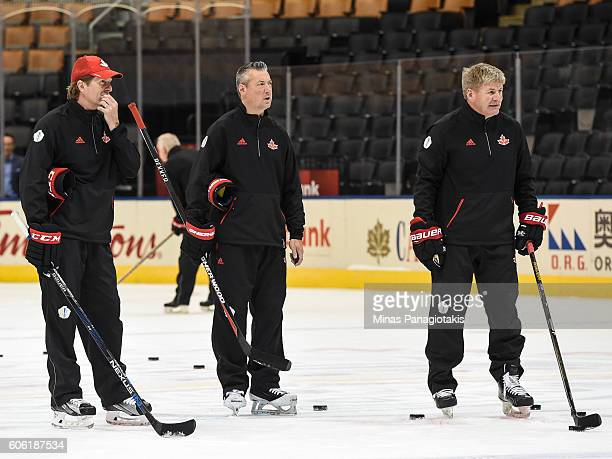 Head coach Mike Babcock goaltending coach Stephane Waite and and assistant coach Bill Peters look on during practice at the World Cup of Hockey 2016...
