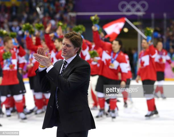 Head coach Mike Babcock of Canada applauds his team following their 30 victory during the Men's Ice Hockey Gold Medal match on Day 16 of the 2014...
