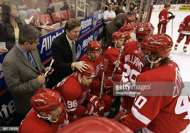 Head Coach Mike Babcock of the Detroit Red Wings gives his players instructions from the bench during a break in play in their NHL game against the...