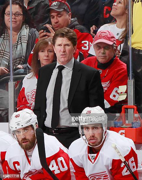 Head coach Mike Babcock of the Detroit Red Wings looks on against the New Jersey Devils at the Prudential Center on November 28 2014 in Newark New...