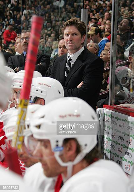 Head Coach Mike Babcock of the Detroit Red Wings looks on from the bench during their NHL game against the Vancouver Canucks at General Motors Place...