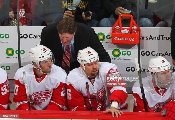 Head Coach Mike Babcock of the Detroit Red Wings skates against the Colorado Avalanche at the Pepsi Center on December 4 2011 in Denver Colorado The...