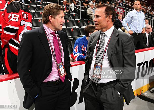 Head coach Mike Babcock of the Detroit Red Wings speaks to Adam Oates of the Washington Capitals at the 2013 NHL Draft at Prudential Center on June...