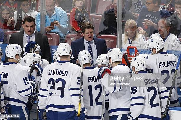 Head Coach Mike Babcock of the Toronto Maple Leafs directs the players during a time out against the Florida Panthers at the BBT Center on December...