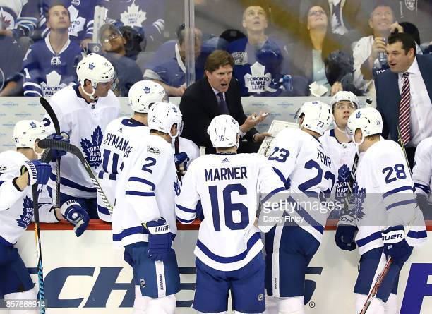 Head Coach Mike Babcock of the Toronto Maple Leafs instructs his players during a second period stoppage in play against the Winnipeg Jets at the...