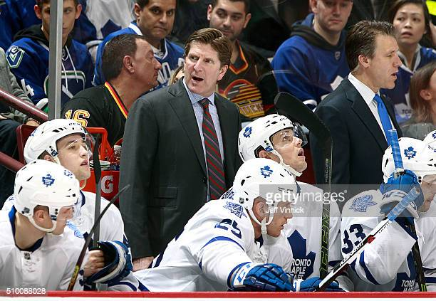 Head coach Mike Babcock of the Toronto Maple Leafs issues instructions during their NHL game against the Vancouver Canucks at Rogers Arena February...
