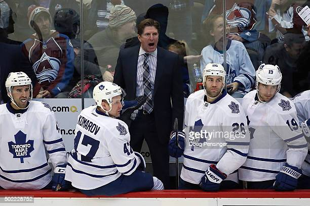 Head coach Mike Babcock of the Toronto Maple Leafs leads his team against the Colorado Avalanche at Pepsi Center on December 21 2015 in Denver...