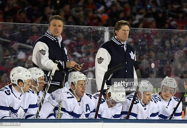 Head coach Mike Babcock of the Toronto Maple Leafs looks on from the bench during the 2018 Coors Light NHL Stadium Series game between the Toronto...