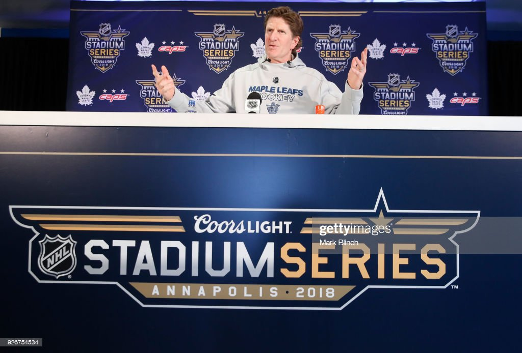 Head Coach Mike Babcock of the Toronto Maple Leafs speaks at the podium during media availability prior to the Coors Light NHL Stadium Series game between the Toronto Maple Leafs and the Washington Capitals at United States Naval Academy on March 3, 2018 in Annapolis, Maryland.