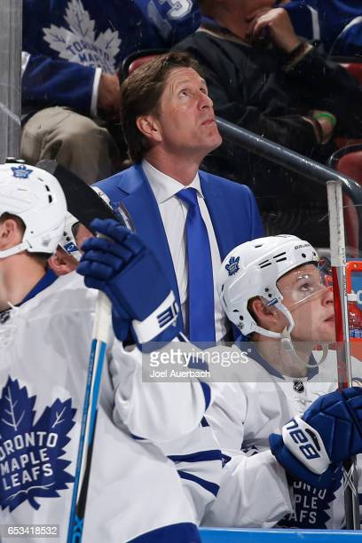 Head Coach Mike Babcock of the Toronto Maple Leafs watches a replay of a goal under review against the Florida Panthers at the BBT Center on March 14...