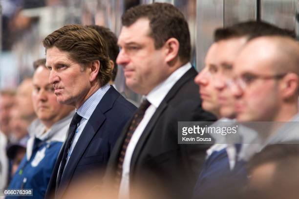 Head Coach Mike Babcock of the Toronto Maple Leafs watches his team battle against Tampa Bay Lightning during the third period at the Air Canada...