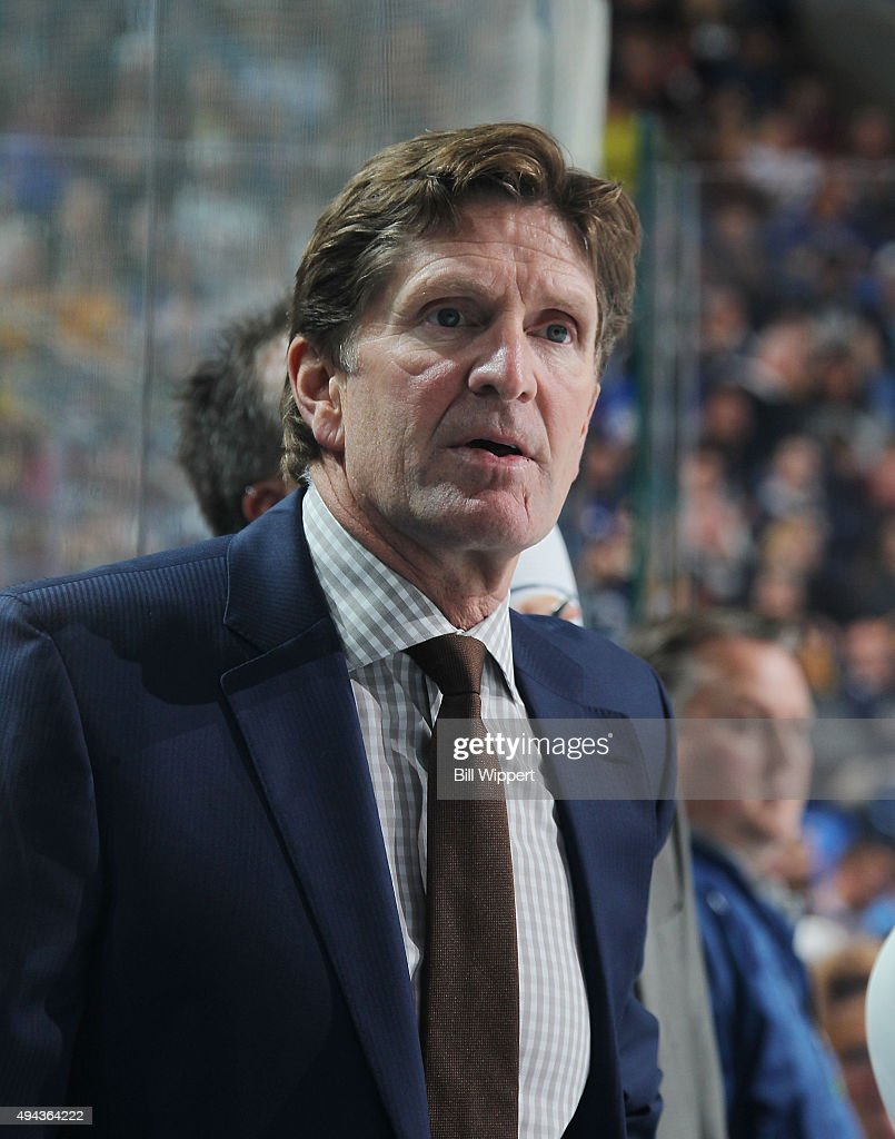 Head coach Mike Babcock of the Toronto Maple Leafs watches the action during an NHL game against the Buffalo Sabres on October 21, 2015 at the First Niagara Center in Buffalo, New York.