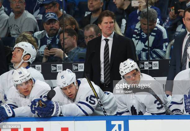 Head coach Mike Babcock of the Toronto Maple Leafs watches the action during an NHL game against the Buffalo Sabres at the KeyBank Center on March 25...