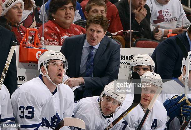 Head coach Mike Babcock of the Toronto Maple Leafs watches third period action against the Arizona Coyotes at Gila River Arena on December 23 2016 in...