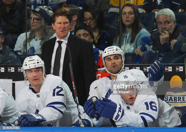 Head coach Mike Babcock Patrick Marleau Nazem Kadri and Mitchell Marner of the Toronto Maple Leafs watch during a 53 loss to the Buffalo Sabres in an...