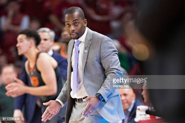 Head Coach Mike Boynton Jr of the Oklahoma State Cowboys directs his team during a game against the Arkansas Razorbacks at Bud Walton Arena on...