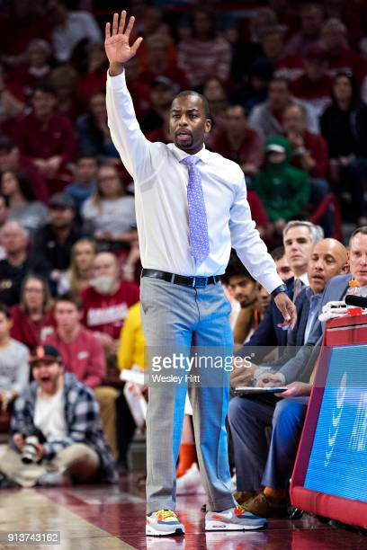 Head Coach Mike Boynton Jr of the Oklahoma State Cowboys signals to his team during a game against the Arkansas Razorbacks at Bud Walton Arena on...