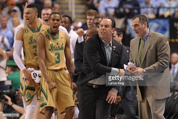 Head Coach Mike Brey of the Notre Dame Fighting Irish and his players react against the North Carolina Tar Heels during the finals of the 2015 Men's...