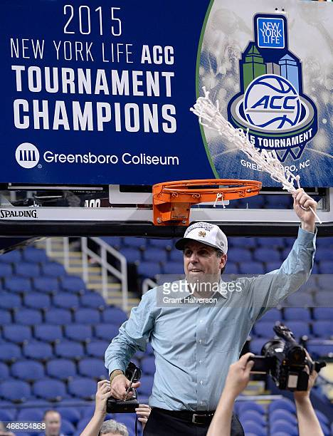 Head coach Mike Brey of the Notre Dame Fighting Irish celebrates after defeating the North Carolina Tar Heels 9082 to win the 2015 ACC Basketball...