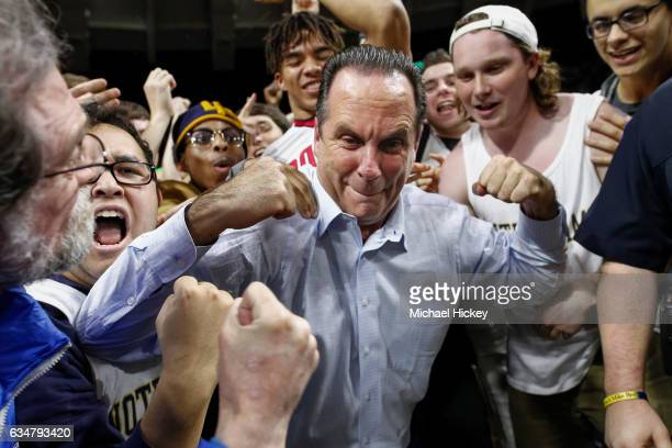 Head coach Mike Brey of the Notre Dame Fighting Irish celebrates with students after the game against the Florida State Seminoles at Purcell Pavilion...