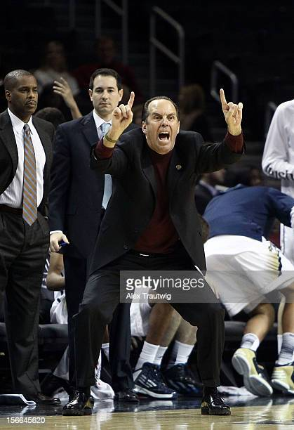 Head coach Mike Brey of the Notre Dame Fighting Irish signals to his team during the consolation game of the Coaches Vs Cancer Classic against the...