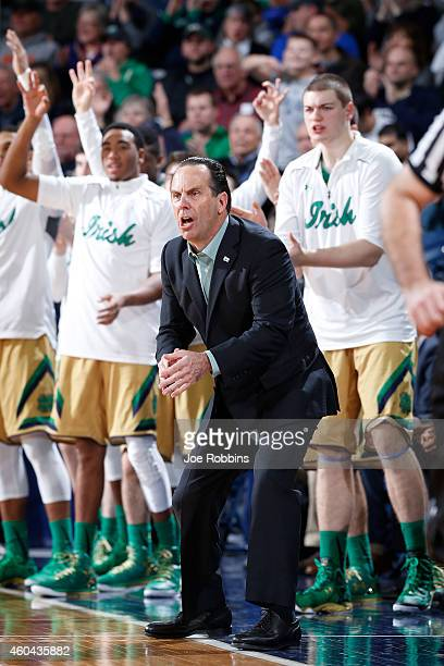 Head coach Mike Brey of the Notre Dame Fighting Irish urges his team on against the Florida State Seminoles during the game at Purcell Pavilion on...