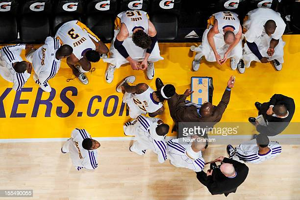 Head Coach Mike Brown of the Los Angeles Lakers draws up plays for his team against the Detroit Pistons at Staples Center on November 4 2012 in Los...