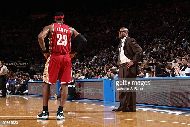 Head Coach mike Brown speaks to LeBron James of Cleveland Cavaliers during game against the New York Knicks on November 6, 2009 at Madison Square...