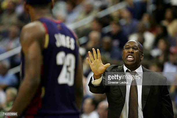 Head coach Mike Brown talks to LeBron James of the Cleveland Cavaliers during their game against the Washington Wizards during Game Four of the...