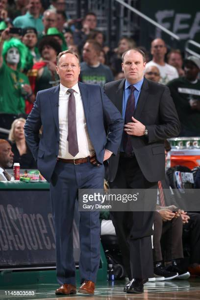 Head Coach Mike Budenholzer and Assistant Coach Taylor Jenkins of the Milwaukee Bucks look on against the Toronto Raptors during Game Five of the...