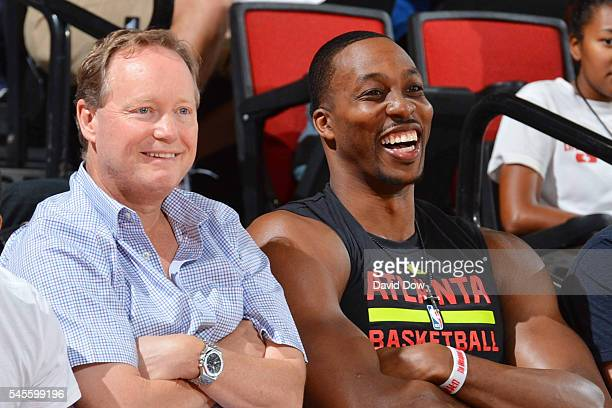 Head coach Mike Budenholzer of the Atlanta Hawks and Dwight Howard of the Atlanta Hawks attend the game against the Houston Rockets during the 2016...