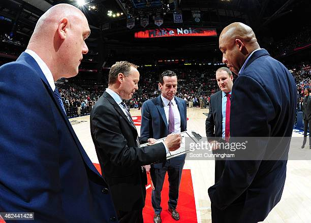 Head Coach Mike Budenholzer of the Atlanta Hawks discusses a play with Assistant Coaches Neven Spahjia Kenny Atkinson Taylor Jenkins and Darvin Ham...