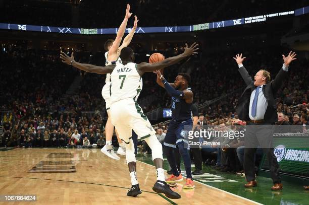Head coach Mike Budenholzer of the Milwaukee Bucks reacts to a play during the second half of a game against the Memphis Grizzlies at Fiserv Forum on...