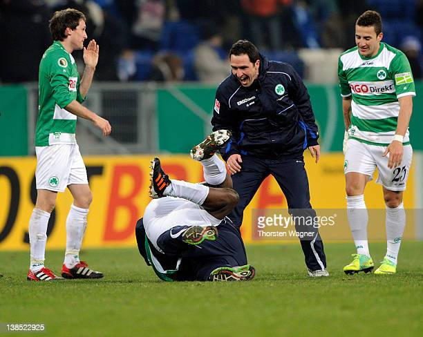 Head coach Mike Bueskens celebrates with Gerald Asamoah after winning the DFB Cup Quarter Final match between TSG 1899 Hoffenheim and SpVgg Greuther...