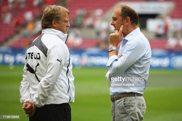 Head coach Mike Bueskens of Duesseldorf and manager Joerg Schmadtke of Koeln talk prior to the Second Bundesliga match between 1 FC Koeln and Fortuna...