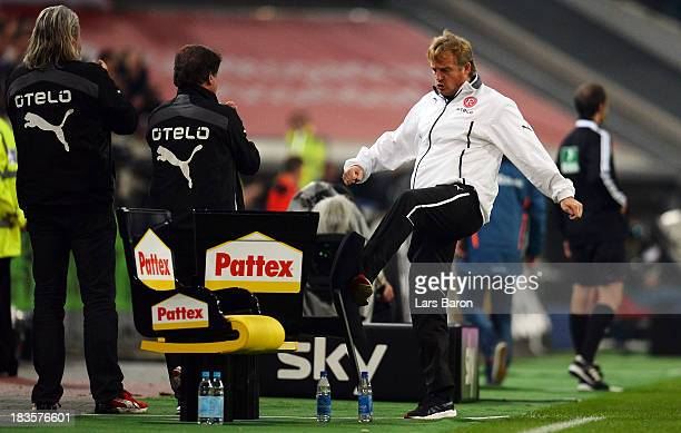 Head coach Mike Bueskens of Duesseldorf kicks a chair after his teams first goal during the Second Bundesliga match between Fortuna Duesseldorf and...
