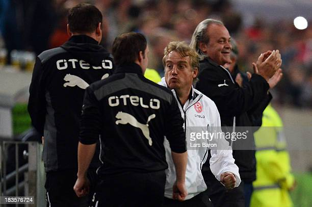 Head coach Mike Bueskens of Duesseldorf reacts after his team scored the second goal during the Second Bundesliga match between Fortuna Duesseldorf...