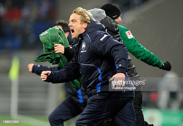 Head coach Mike Bueskens of Fuerth celebrates after winning the DFB Cup Quarter Final match between TSG 1899 Hoffenheim and SpVgg Greuther Fuerth at...